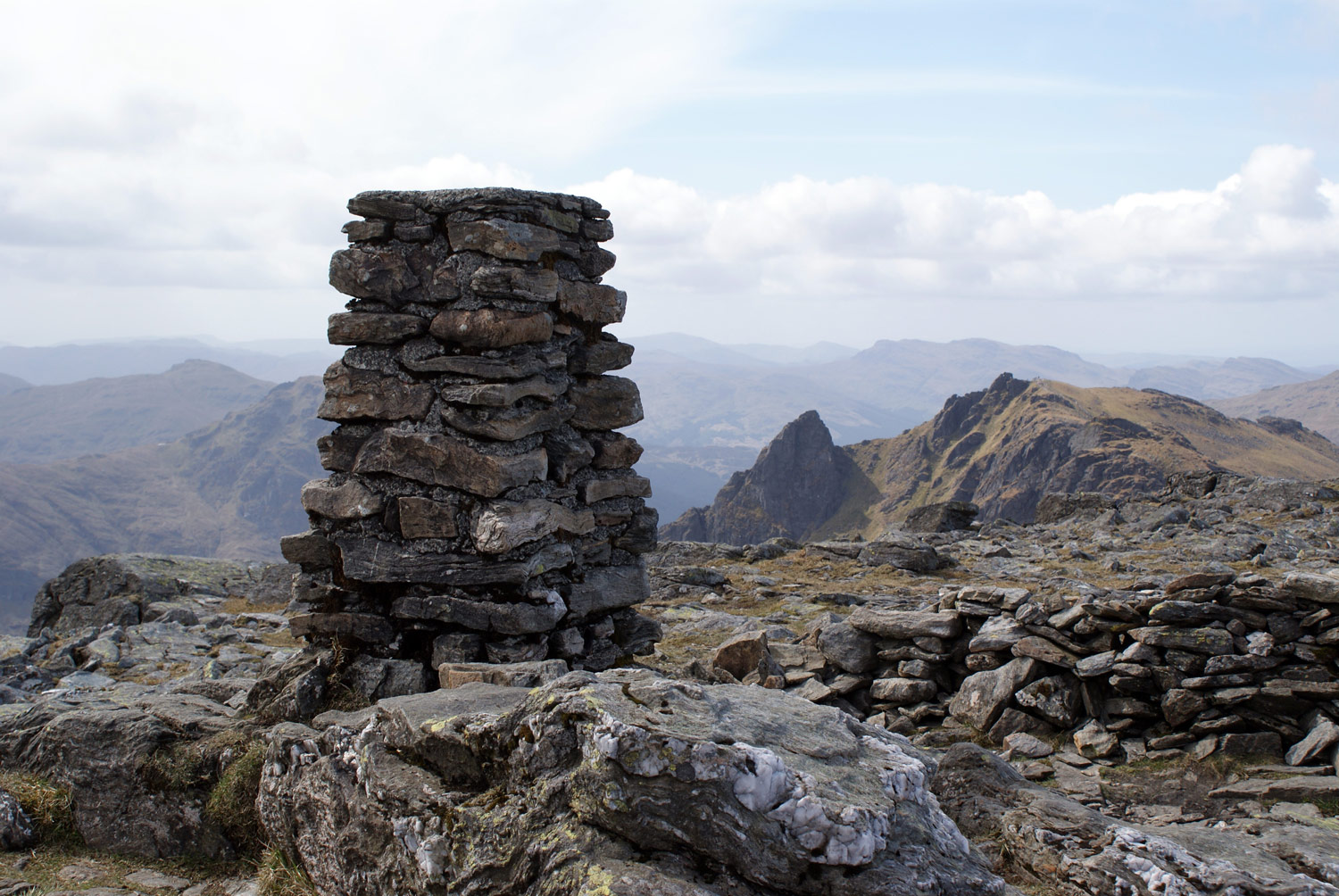 Trig point overlooking The Cobbler.