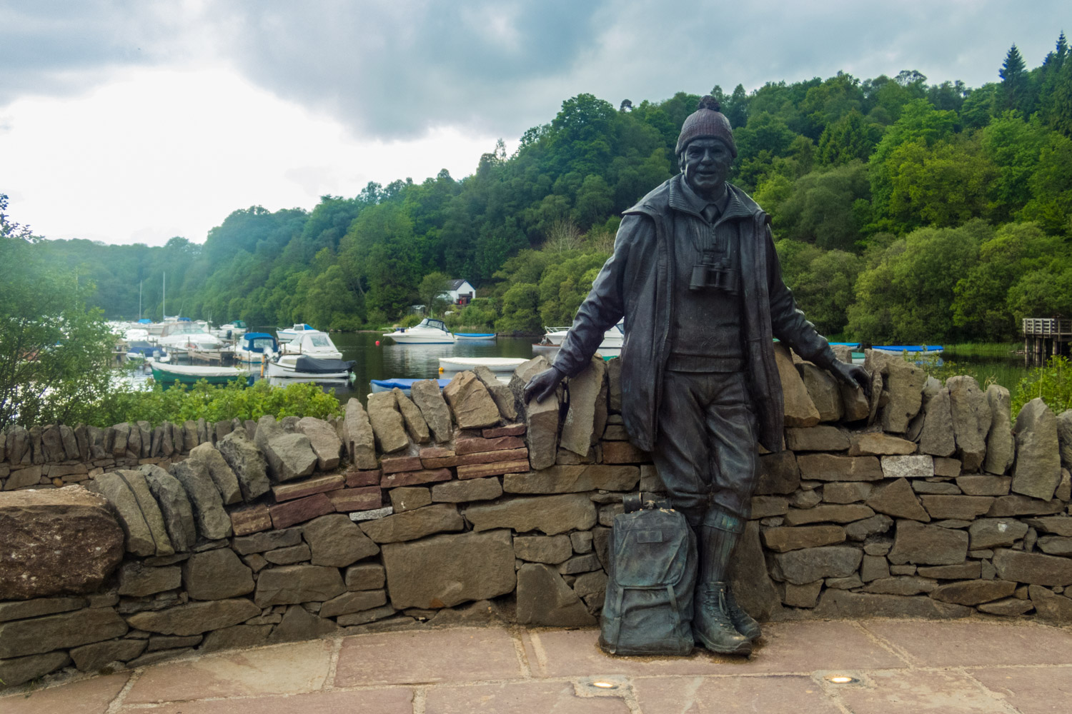 Tom Weir statue overlooking Balmaha Bay on the shores of Loch Lomond.